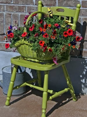 green chair and red flowers